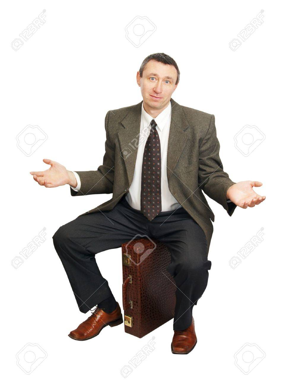 Confused man sits on suitcase Stock Photo - 12721745