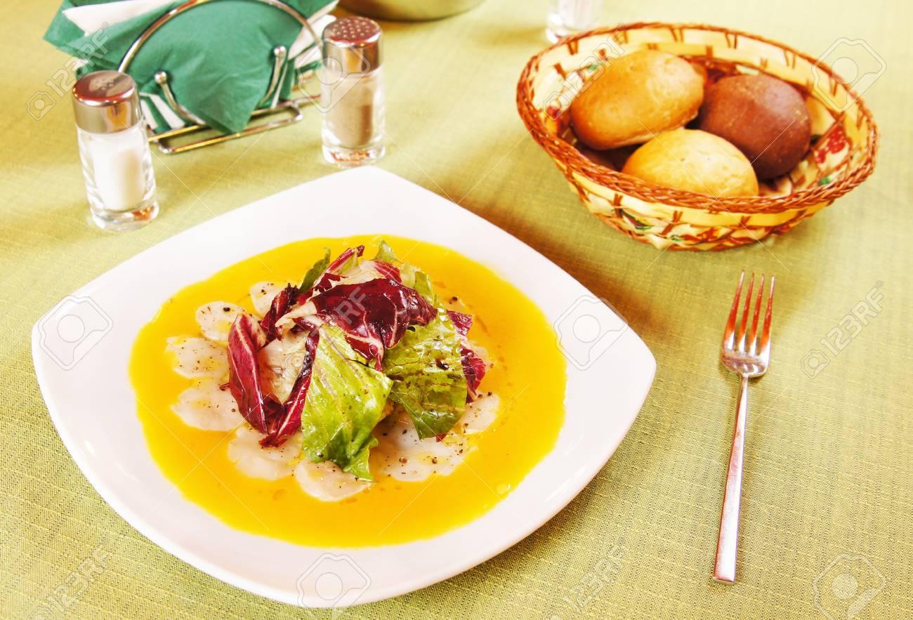 Carpaccio made of sea scallops in a plate Stock Photo - 15716997