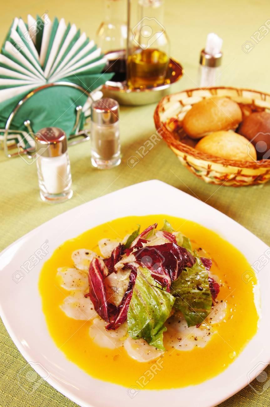 Carpaccio made of sea scallops on a laid table Stock Photo - 15717012