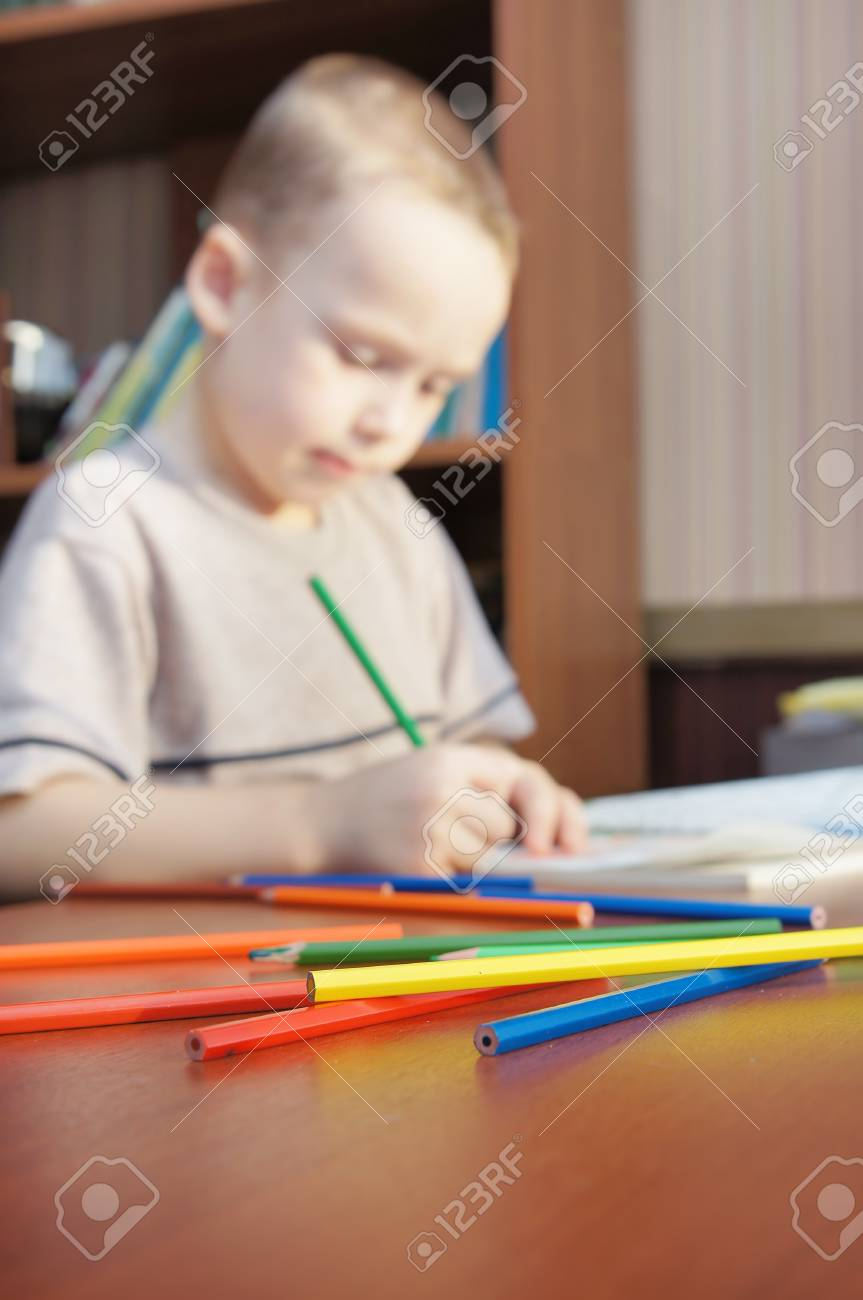 Little boy is learning to draw with pencils (focus on pencils) Stock Photo - 16104165