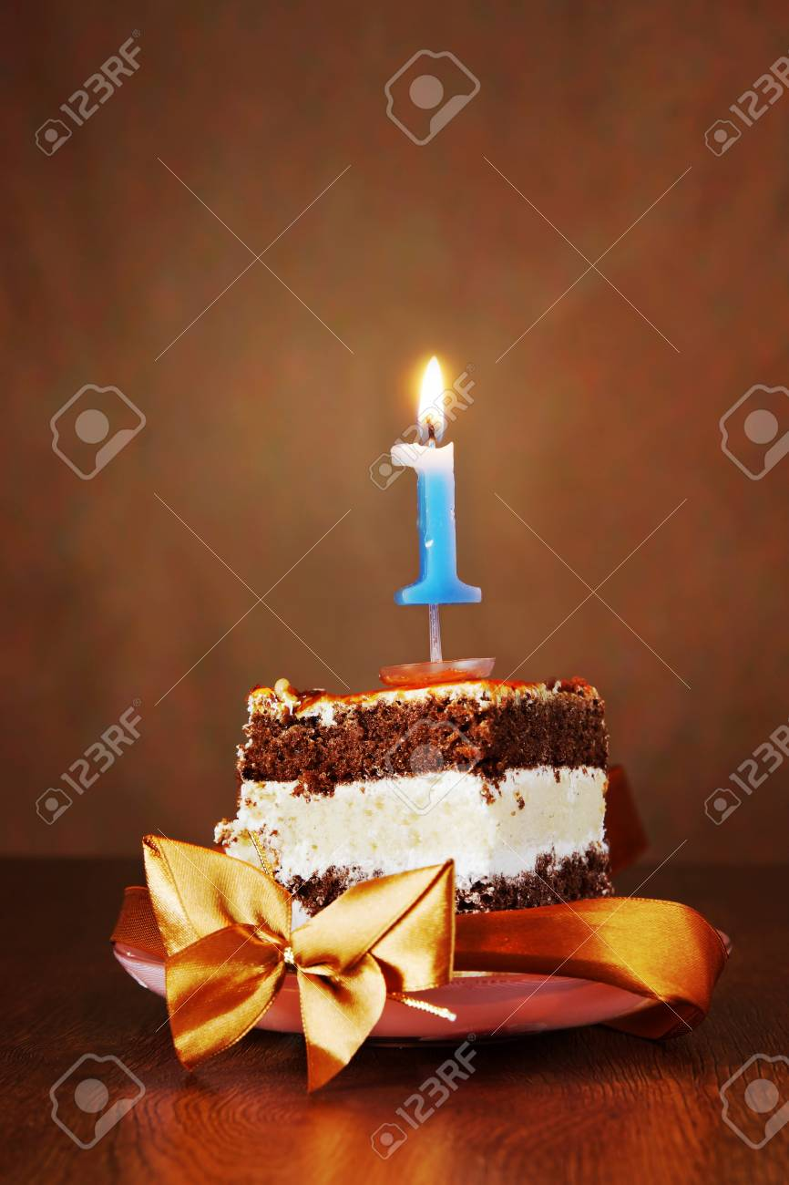 Piece Of Birthday Chocolate Cake With Burning Candle As A Number