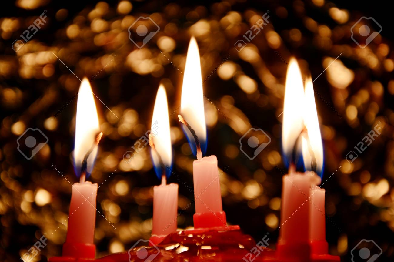 Birthday Cake With Candles And Bohke In The Dark Room Stock Photo