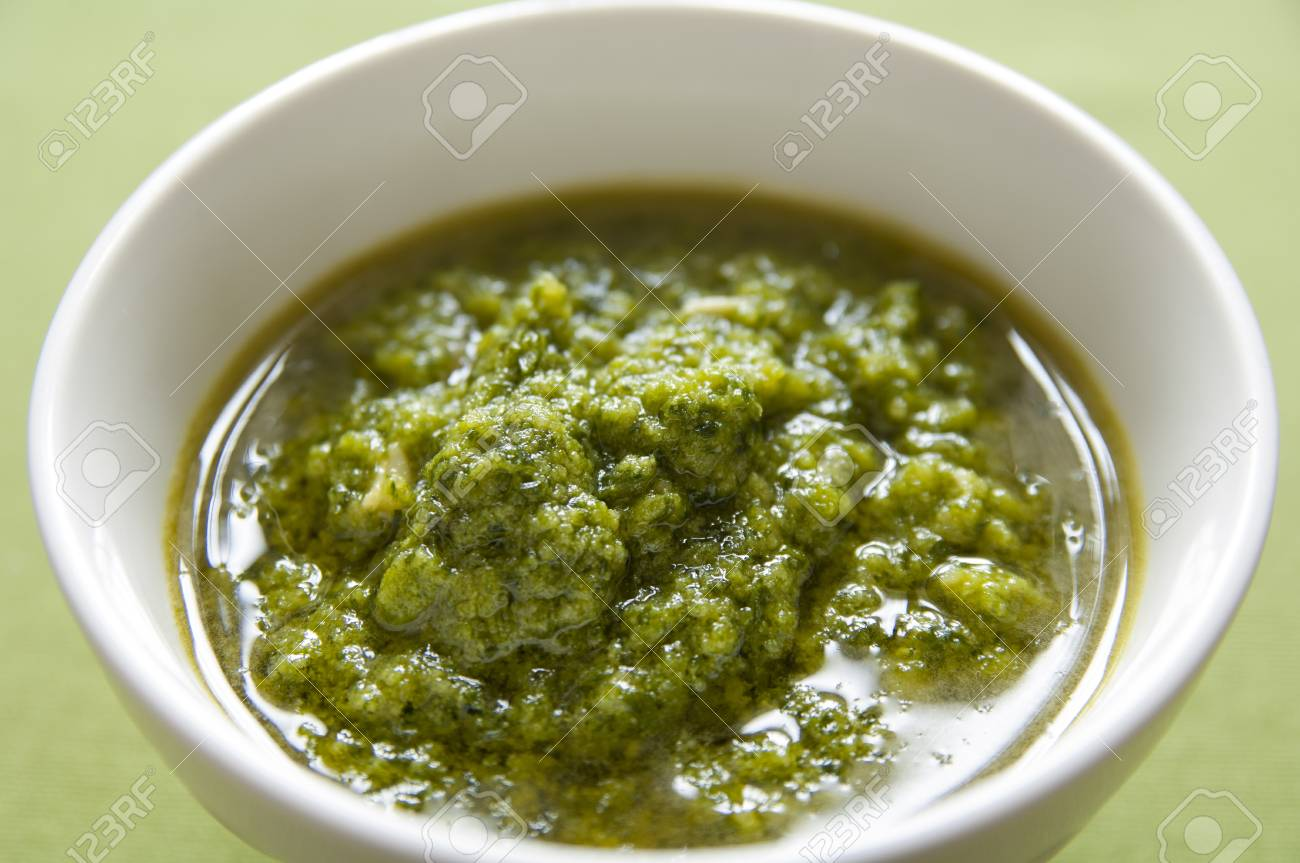 Close-up view of organic italian traditional Pesto sauce in a bowl Stock Photo - 17824624