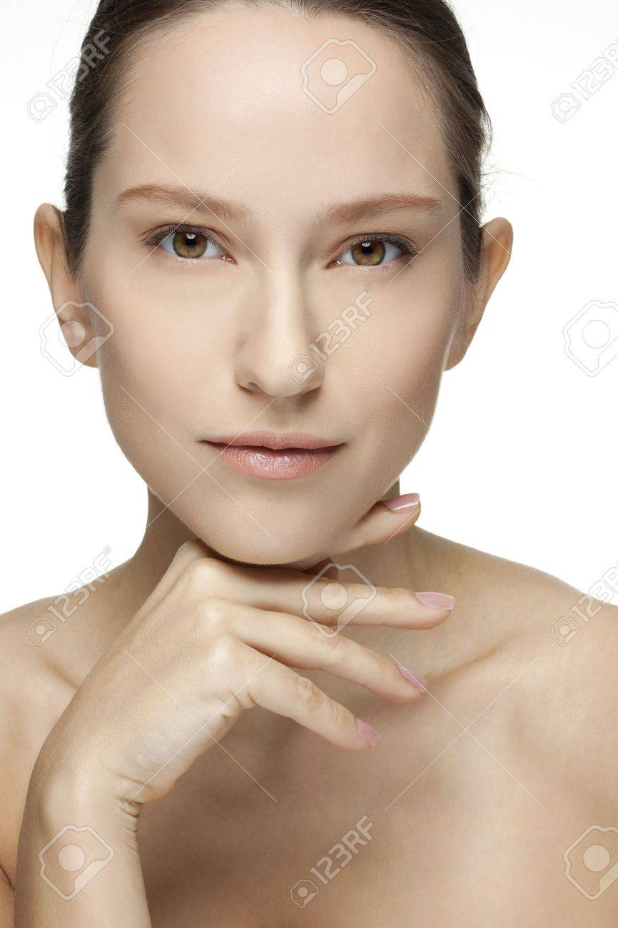Beautiful Young Woman touching her Face  Skincare  Perfect Skin  Spa isolated on a white background Stock Photo - 18299542