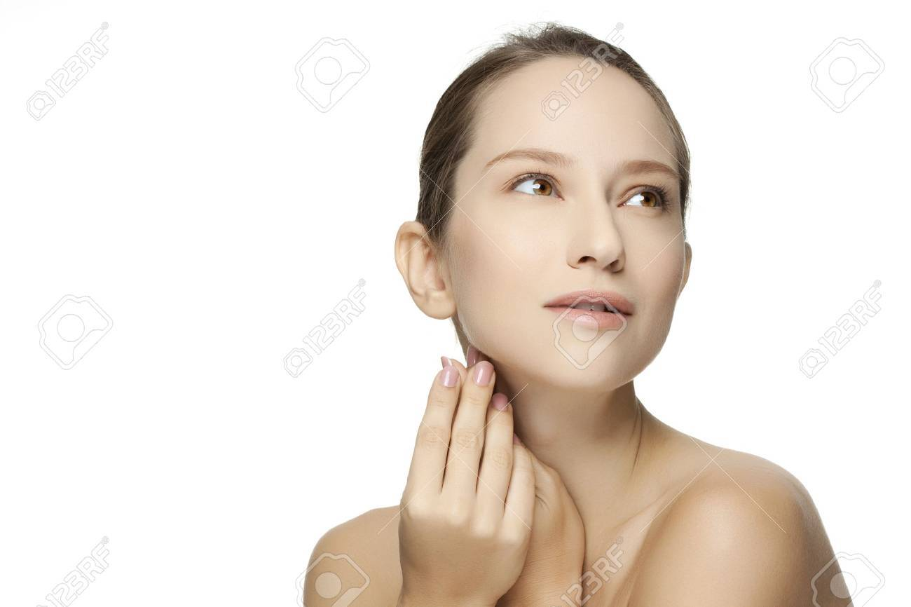 Beautiful Young Woman touching her Face. Skincare .Perfect Skin. Spa isolated on a white background Stock Photo - 18707741