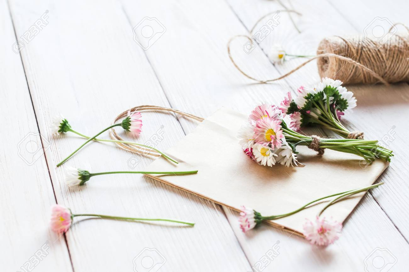 Workspace With Small Bouquets Of Daisy Flowers, Paper Bags. Creation ...