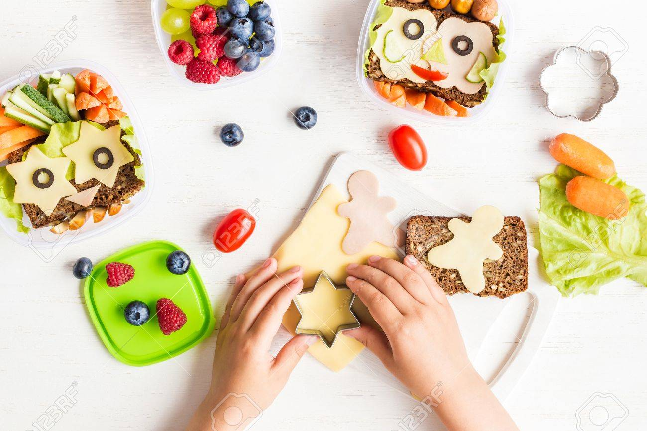 School lunch box for kids. Cooking. Child's hands. Backto school. Top view, flat lay - 82344473