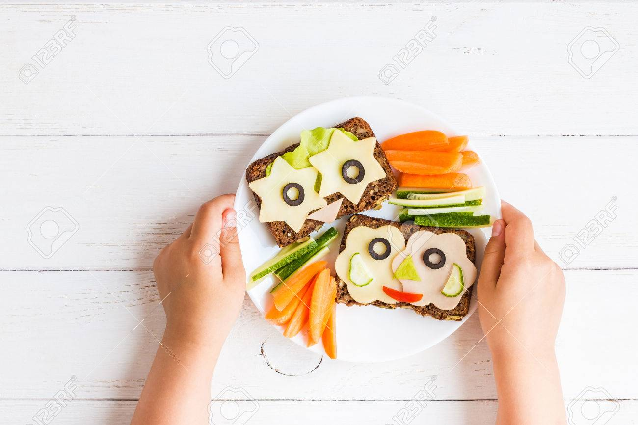 School lunch box for kids. Child's hands. Top view, flat lay - 83376532