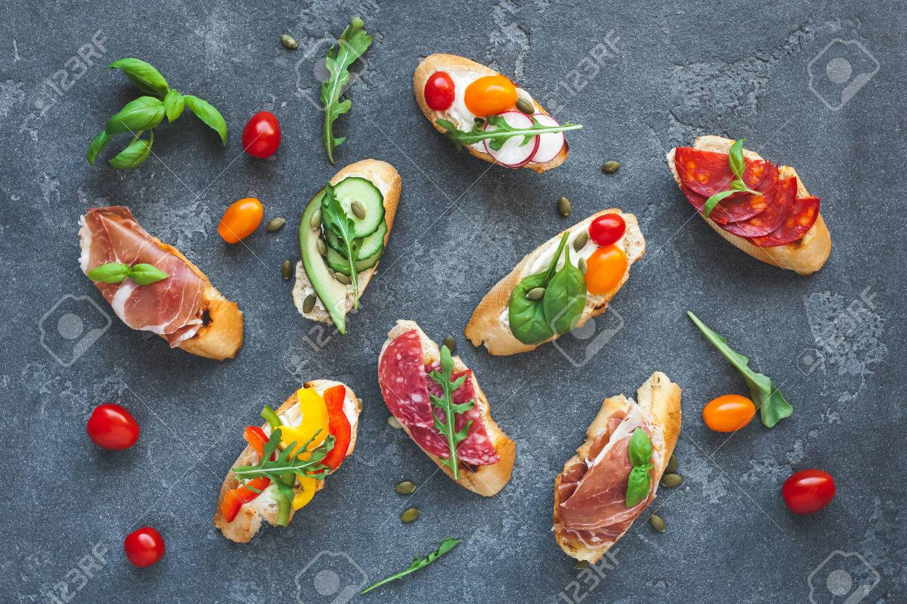 Traditional spanish tapas on dark background. Flat lay, top view - 85839615