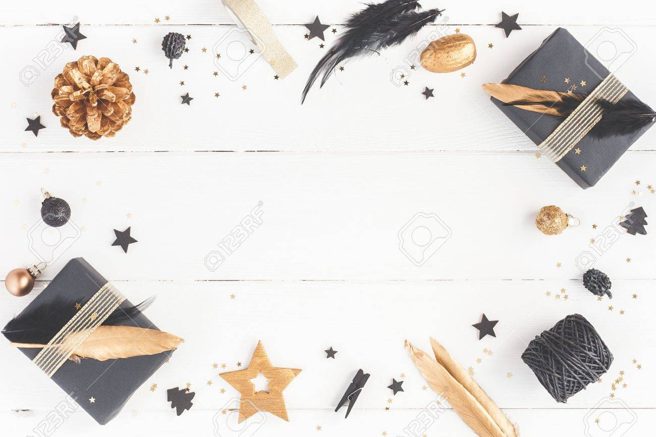 Christmas composition. Christmas gifts, pine cones, black and golden decorations on white wooden background. Flat lay, top view, copy space - 86954463