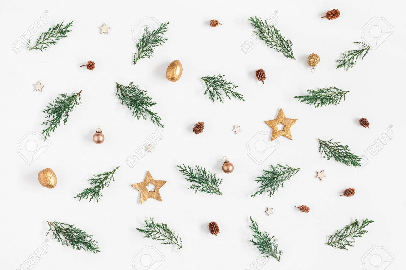 Christmas composition. Pattern made of pine branches and christmas decorations on white background. Flat lay, top view - 87491084