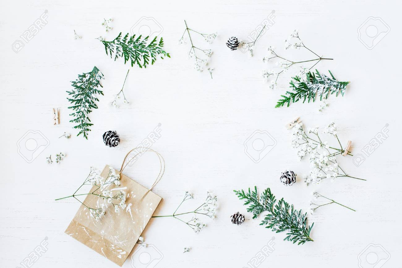 Christmas composition. Christmas gift, pine cones, thuja branches and gypsophila flowers. Top view, flat lay - 88130651