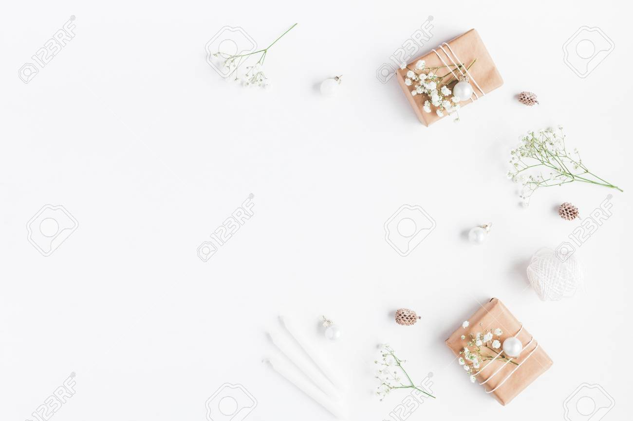 Christmas composition. Frame made of christmas gifts, pine cones, gypsophila flowers on white background. Flat lay, top view, copy space - 89713926