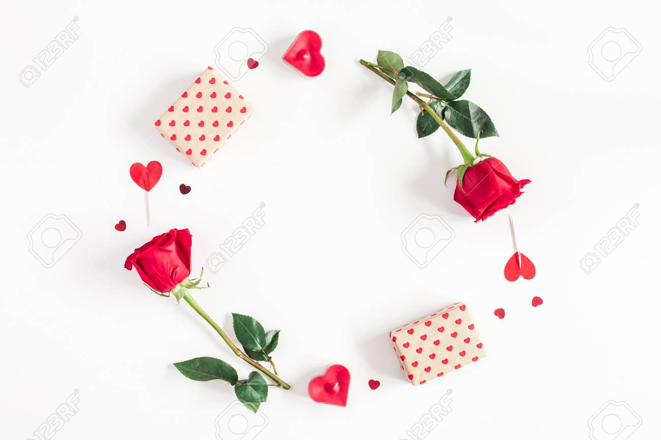 Valentine's Day. Round frame made of rose flowers, gifts, candles, confetti on white background. Valentines day background. Flat lay, top view, copy space - 93204603