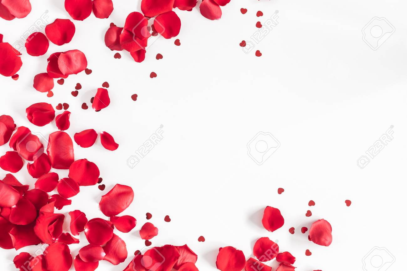 Valentine's Day. Flowers composition. Round frame made of rose flowers, confetti on white background. Valentines day background. Flat lay, top view, copy space - 93204604
