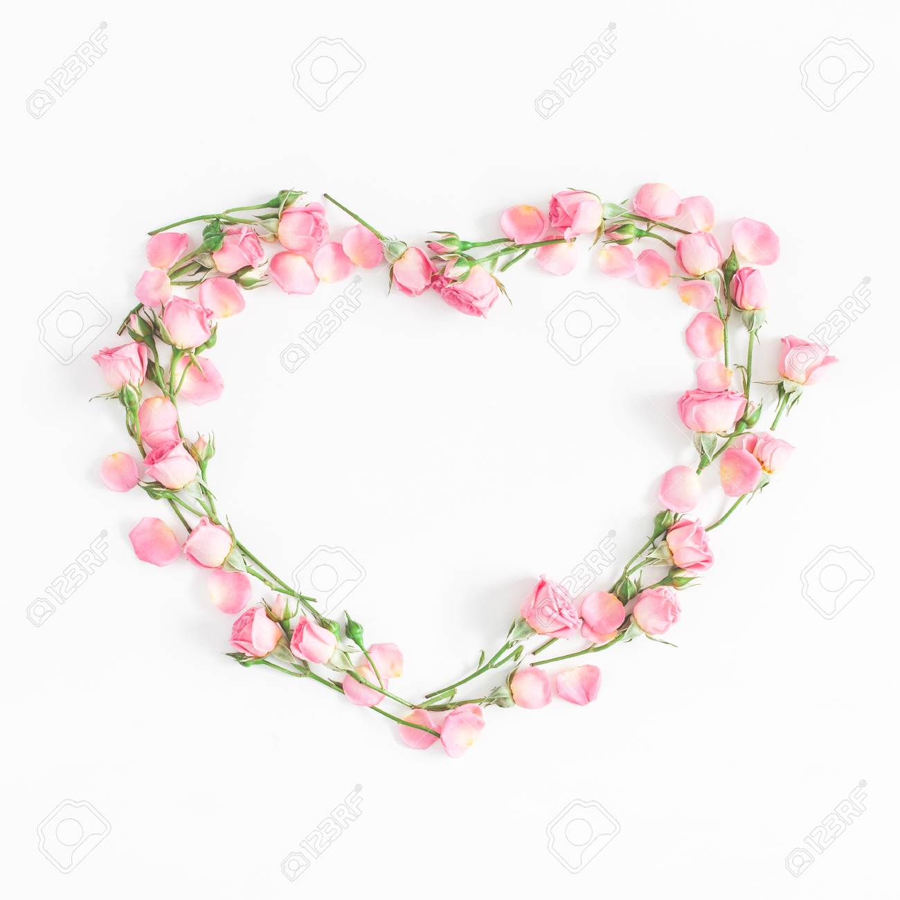 Flowers composition. Heart symbol made of pink rose flowers on white background. Flat lay, top view, copy space, square - 94033564