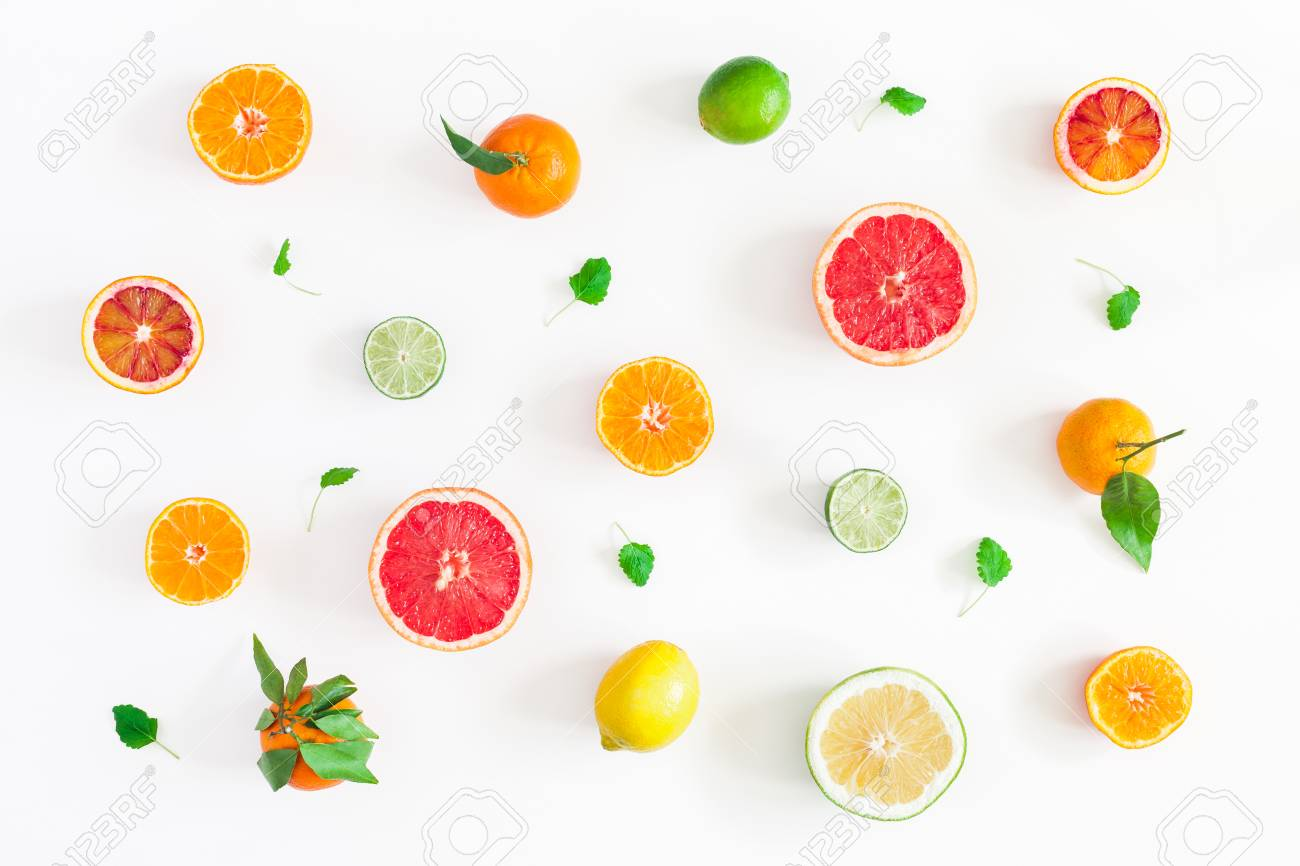 Fruit background. Colorful fresh fruits on white table. Orange, tangerine, lime, lemon, grapefruit. Flat lay, top view - 97103326