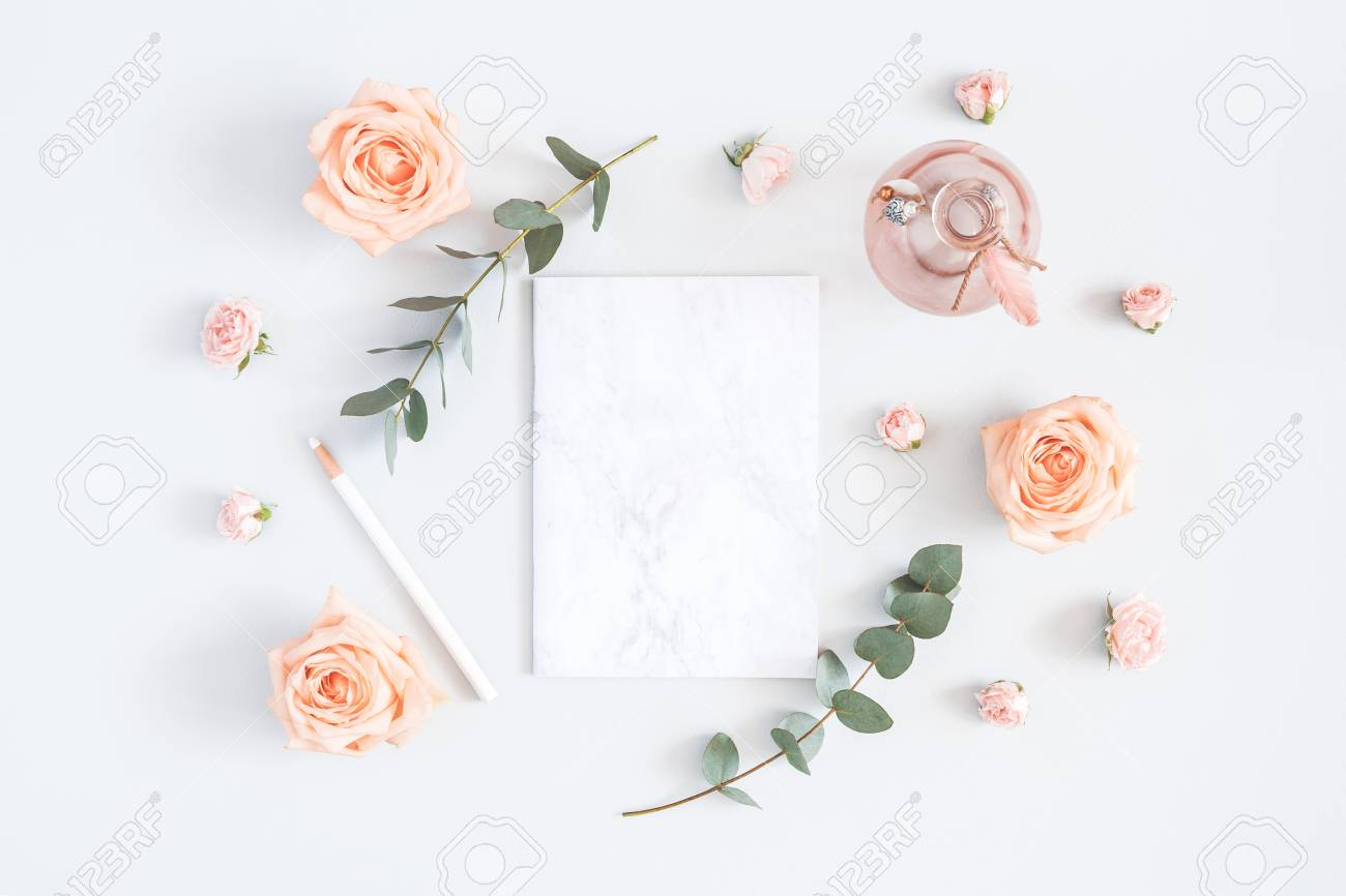 Wedding invitation card. Marble paper blank, rose flowers, eucalyptus branches on gray background. Wedding concept. Flat lay, top view, copy space - 100584531