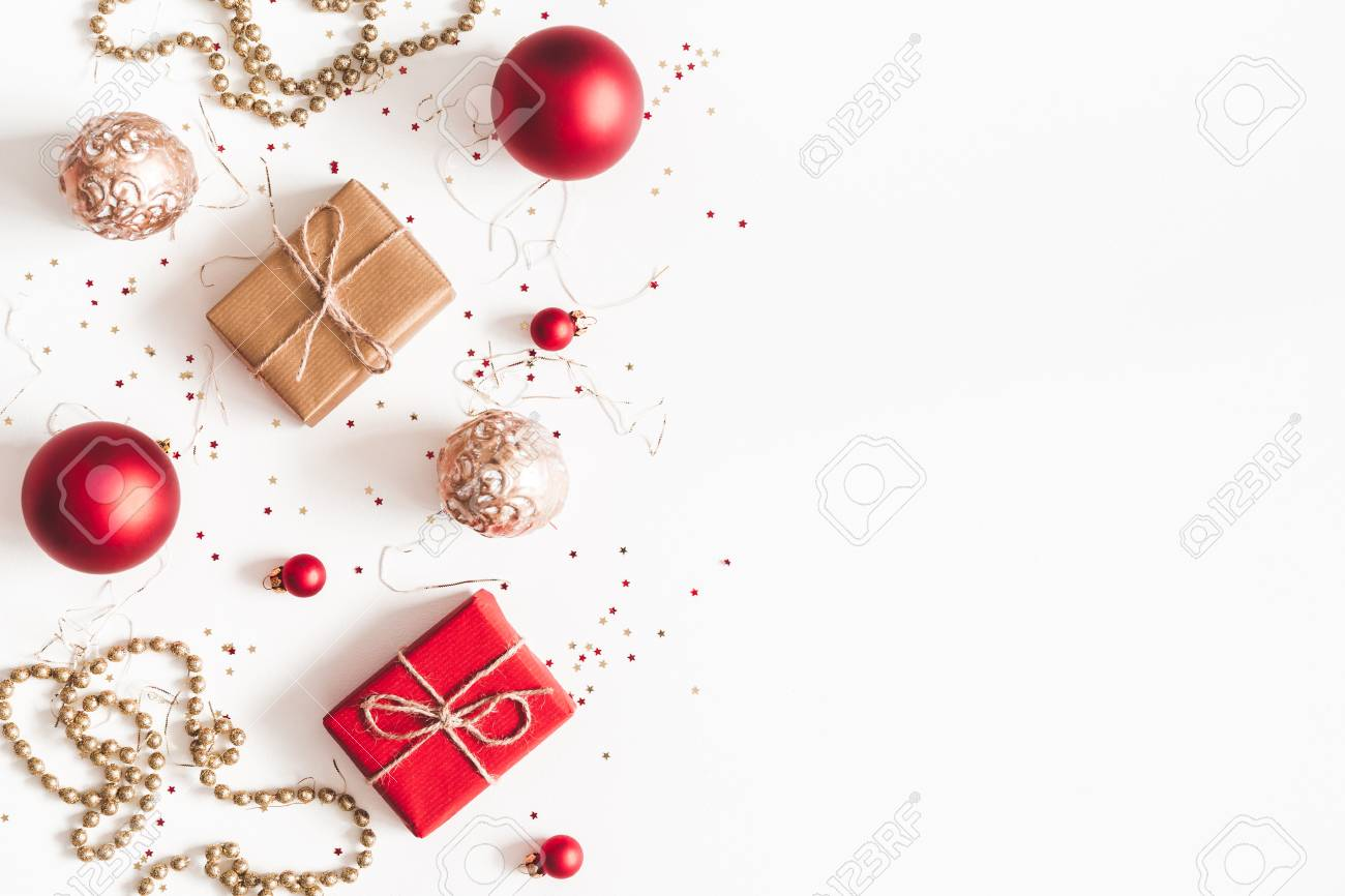 Christmas composition. Christmas gifts, red and golden decorations on white background. Flat lay, top view, copy space - 112230295