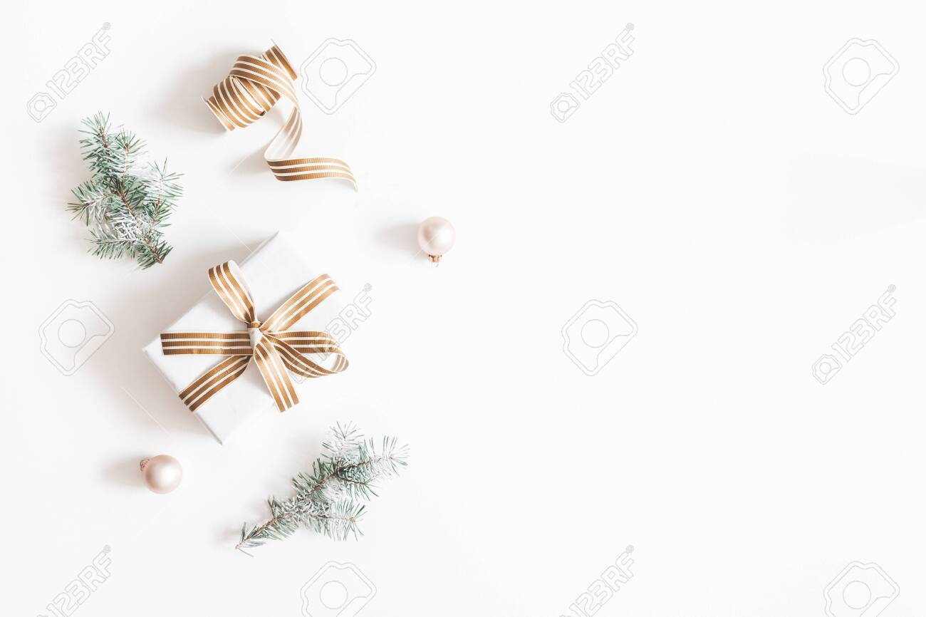 Christmas composition. Gift, fir tree branches, balls on white background. Christmas, winter, new year concept. Flat lay, top view, copy space - 130794762