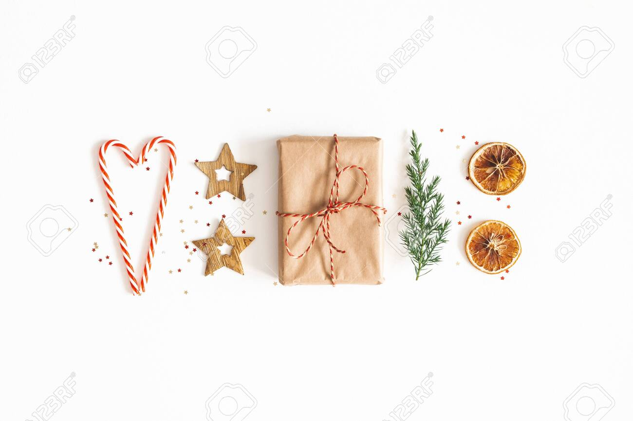 Christmas composition. Gift box, fir tree branches, golden decorations on white background. Christmas, winter, new year concept. Flat lay, top view - 131538168