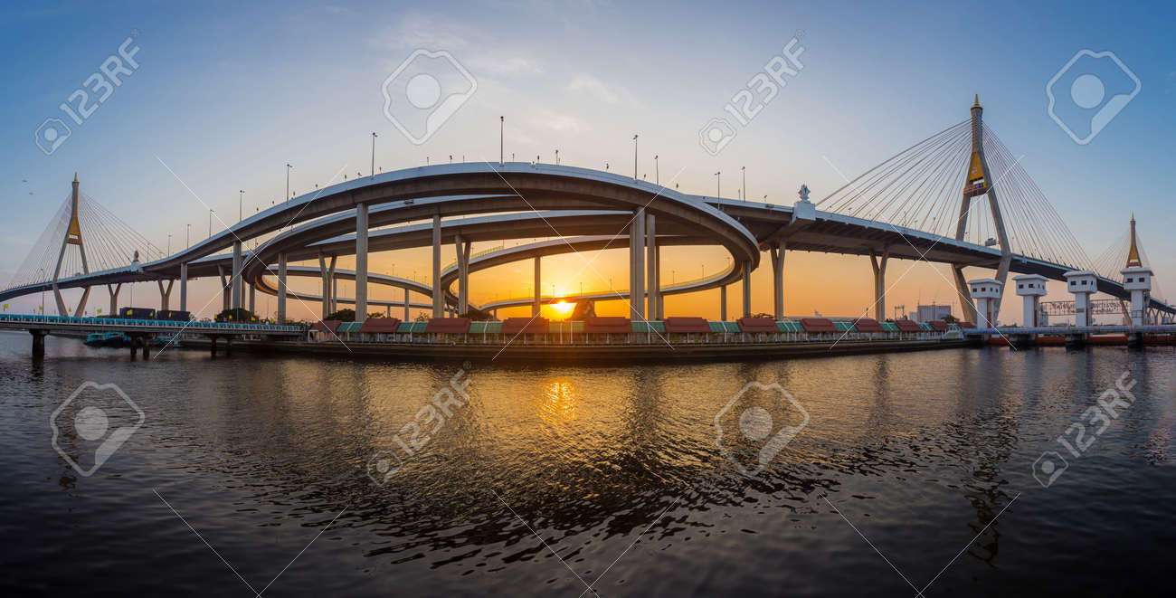 Panorama landscape of Bhumibol Bridge is a large and modern-looking bridge that is an important landmark of Bangkok in sunset time - 169691367
