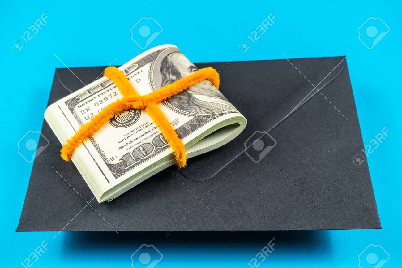 Prop Money Dollars and black envelope Light blue background