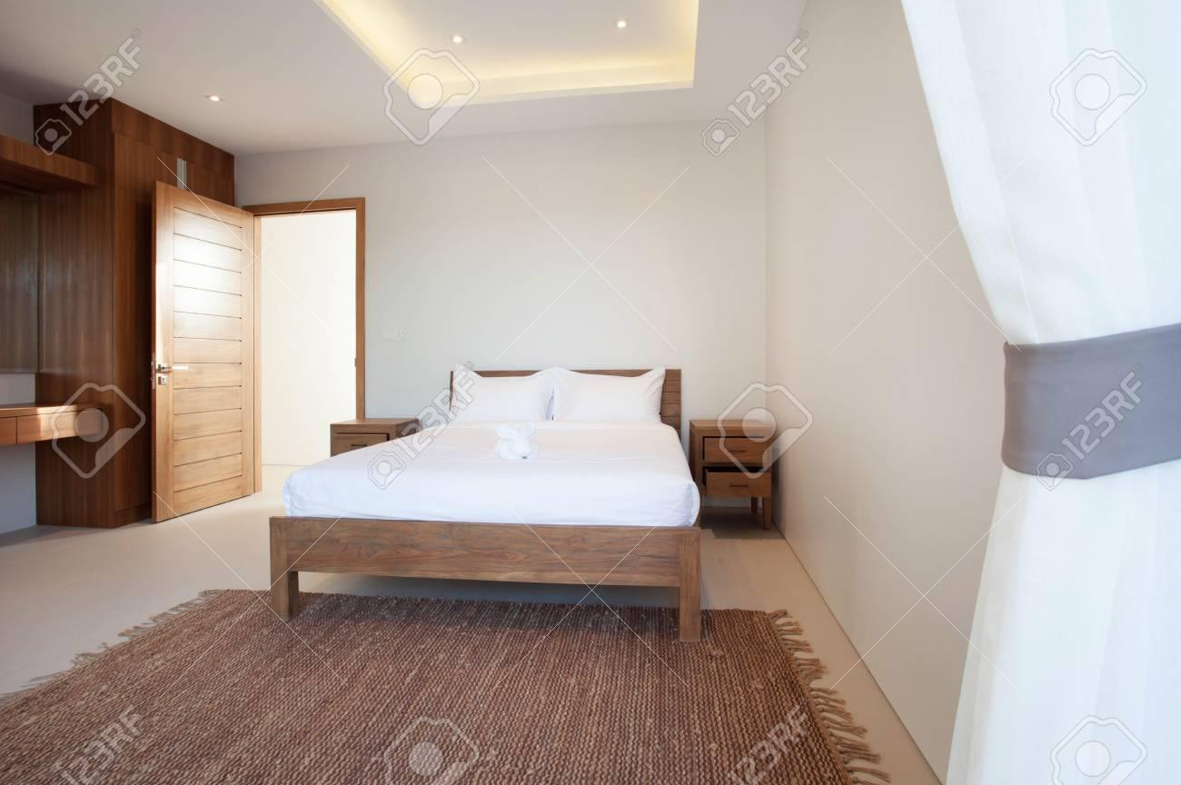 Luxe Interieur Ontwerp : Luxe interieurontwerp in slaapkamer van zwembad villa met gezellig