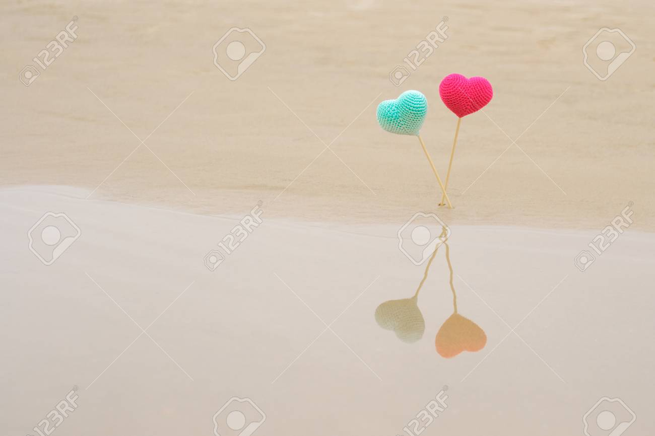 Two Crocheted Bright And Colorful Hearts On Wooden Sticks On.. Stock ...