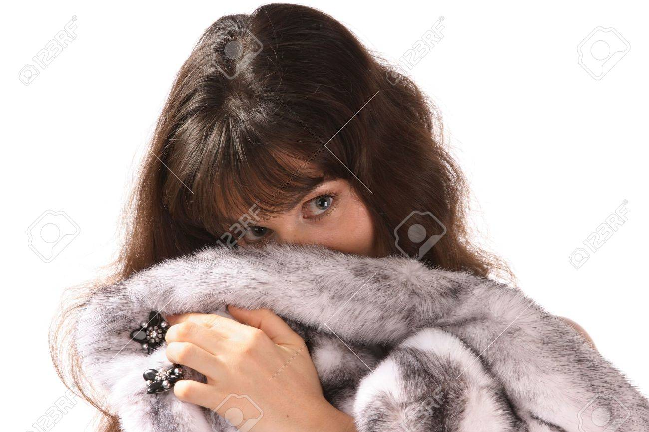 Portrait of  beautiful young woman is in a mink fur coat. Isolated. Stock Photo - 2426153