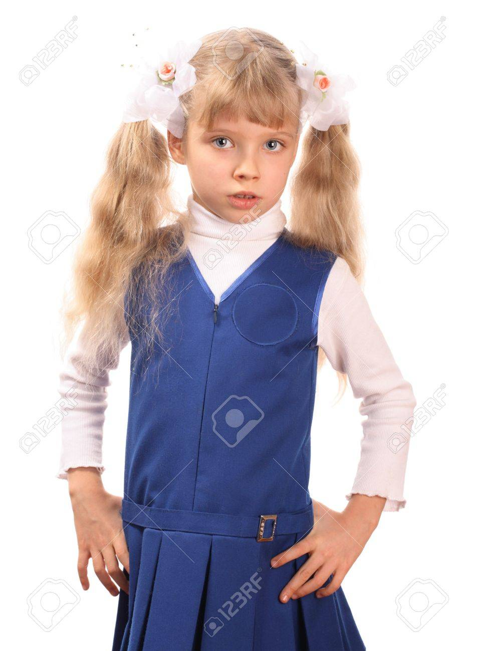 A schoolgirl is in dark blue clothes. Stock Photo - 2513719