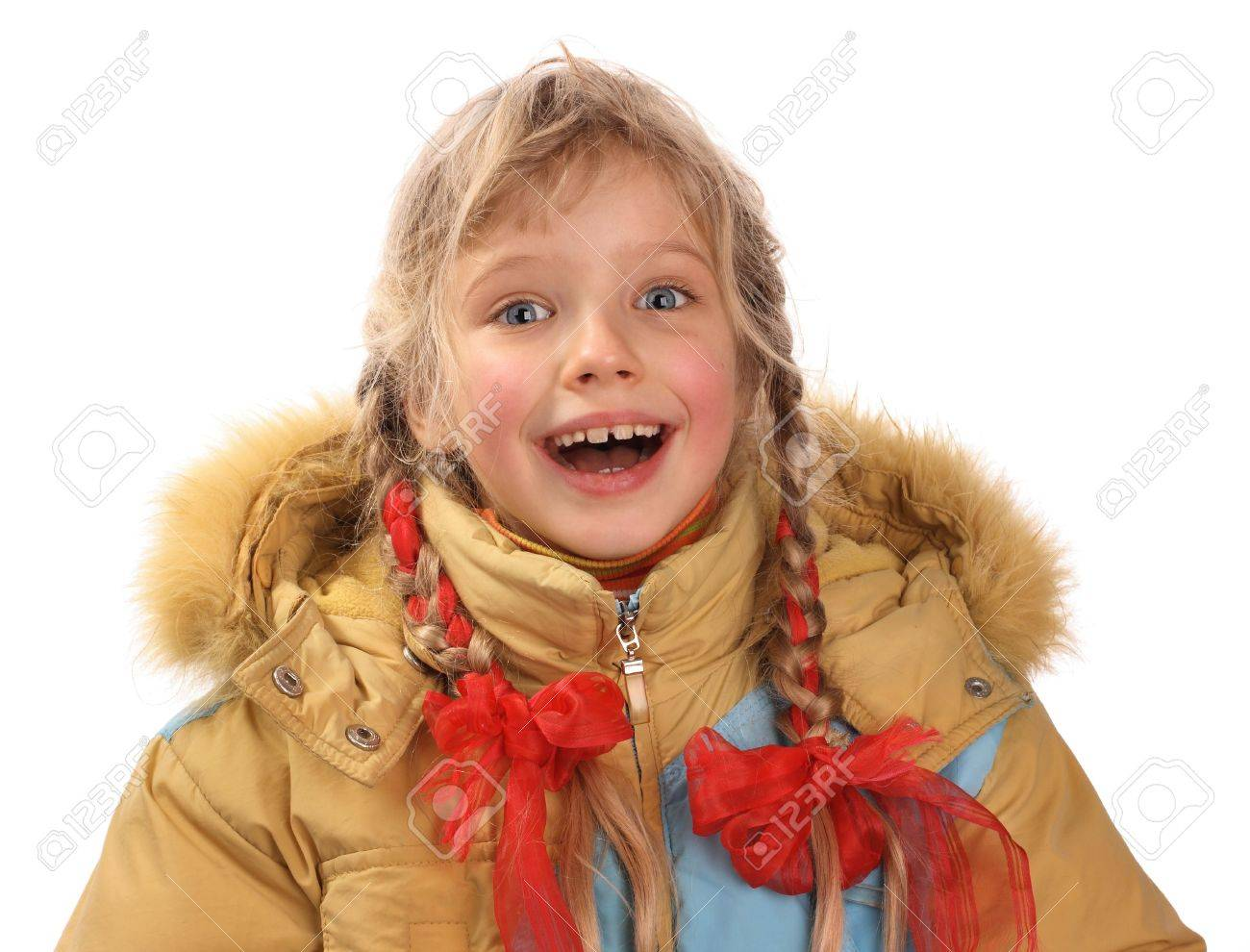 A merry girl is in a yellow jacket. Stock Photo - 2513734