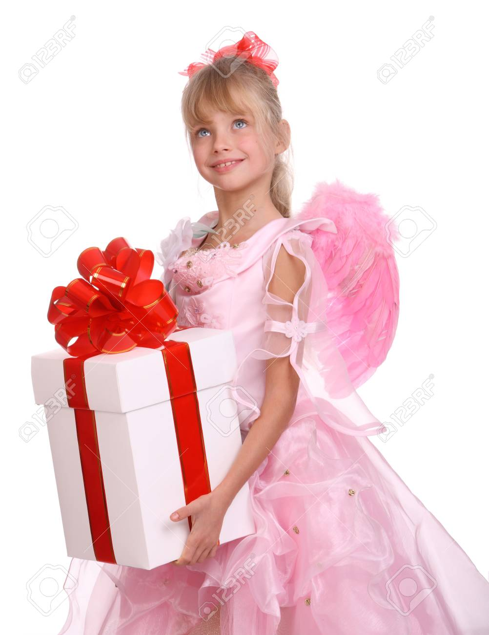 Angel with pink wings and white gift box decorate red bow. Stock Photo - 4002890