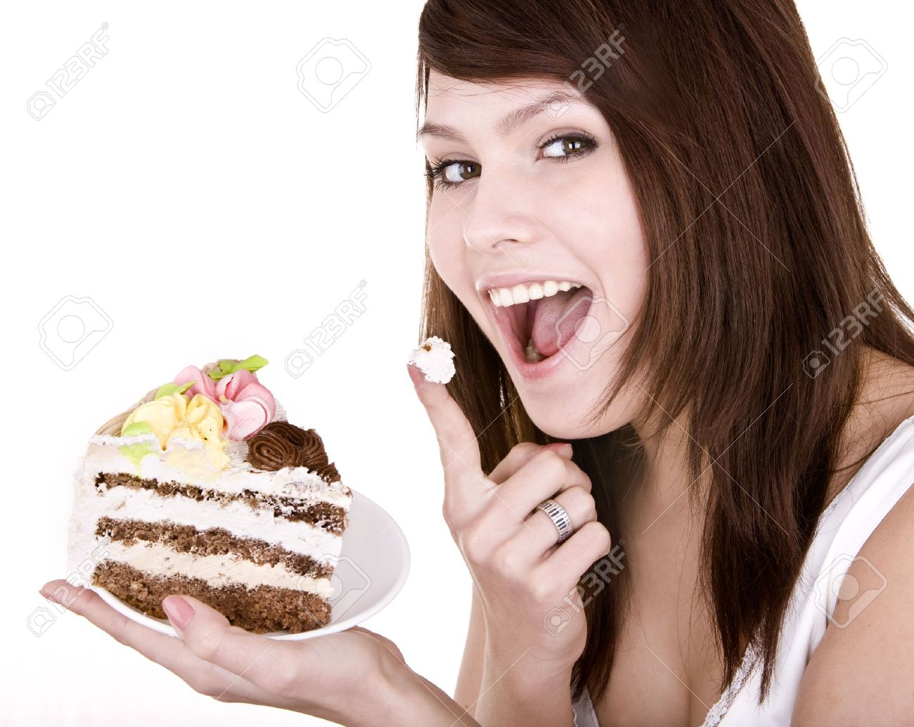Girl eating piece of cake. Isolated. Stock Photo - 4893275