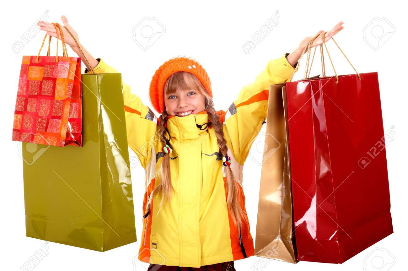 Girl in autumn orange hat with  shopping bag group. Isolated. Stock Photo - 5796847