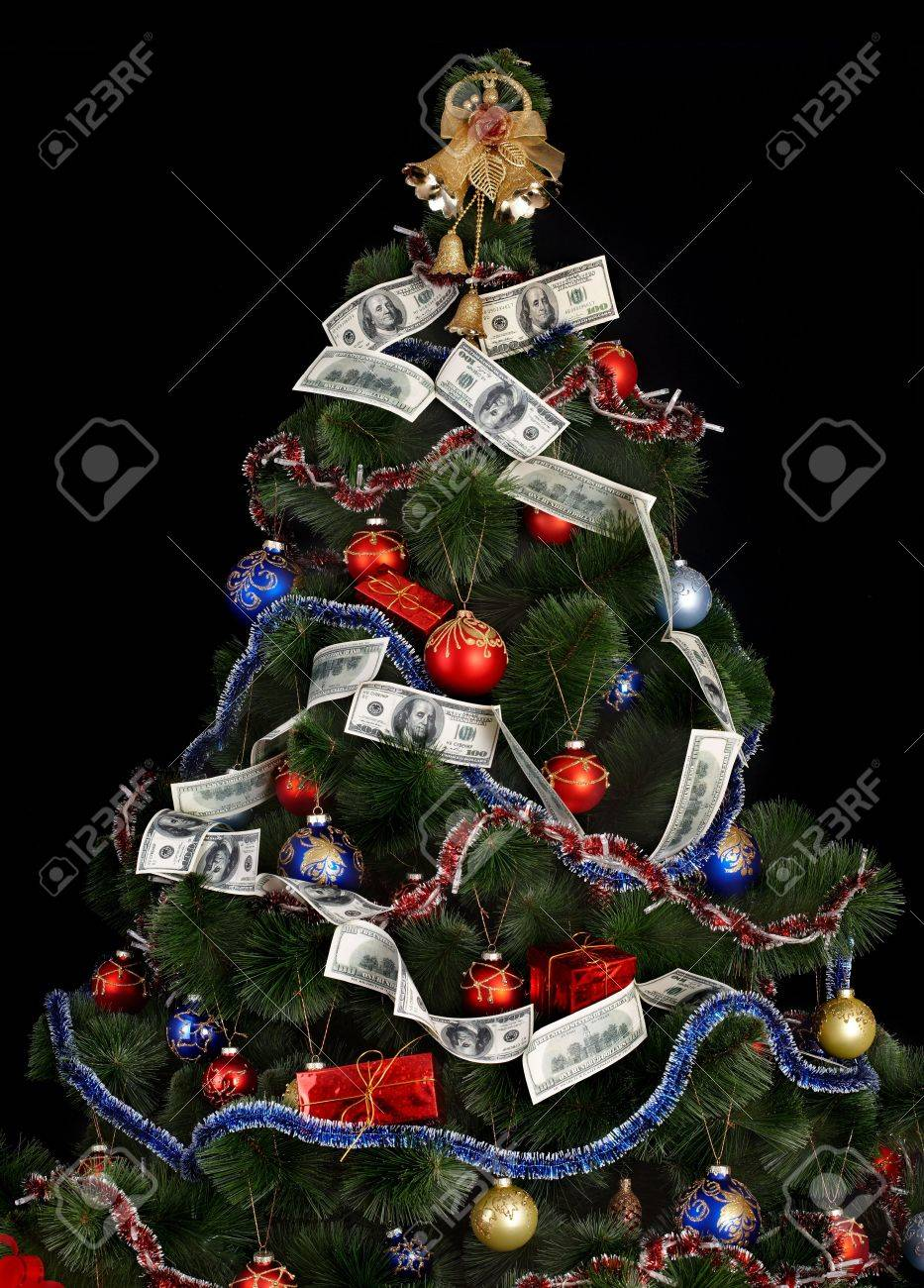 Christmas tree with money dollar garland. Black background. Stock Photo - 5892066