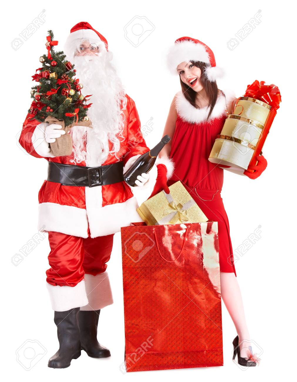 Christmas shopping of girl and santa clause with tree. Isolated. Stock Photo - 5945502