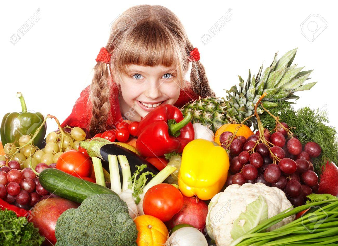 Child girl with group of vegetable and fruit. Isolated. Stock Photo - 6050135