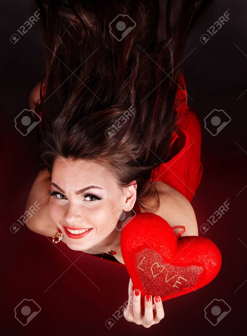 Girl with heart  in red flying.Valentines day. Stock Photo - 6283931