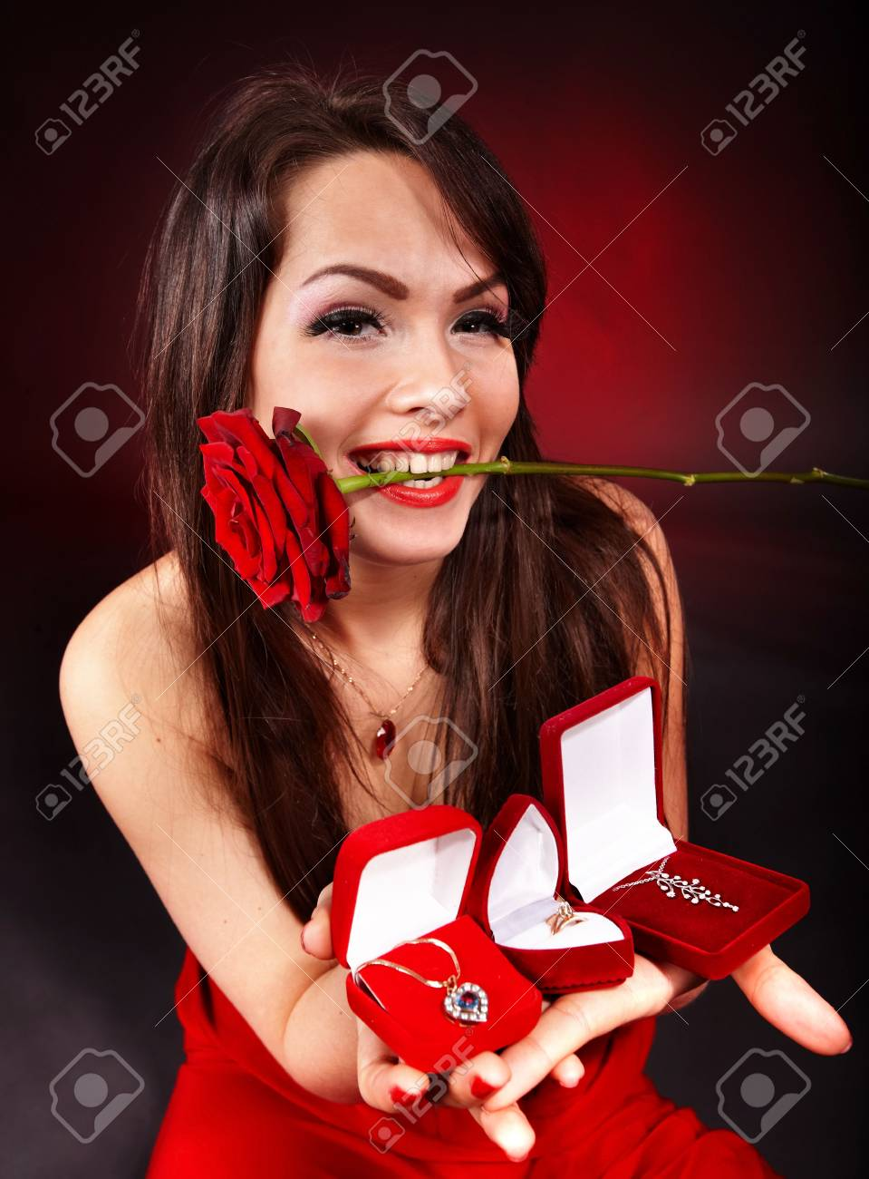 Girl with group jewellery gift box and rose on red  background.   Valentines day. Stock Photo - 6283875
