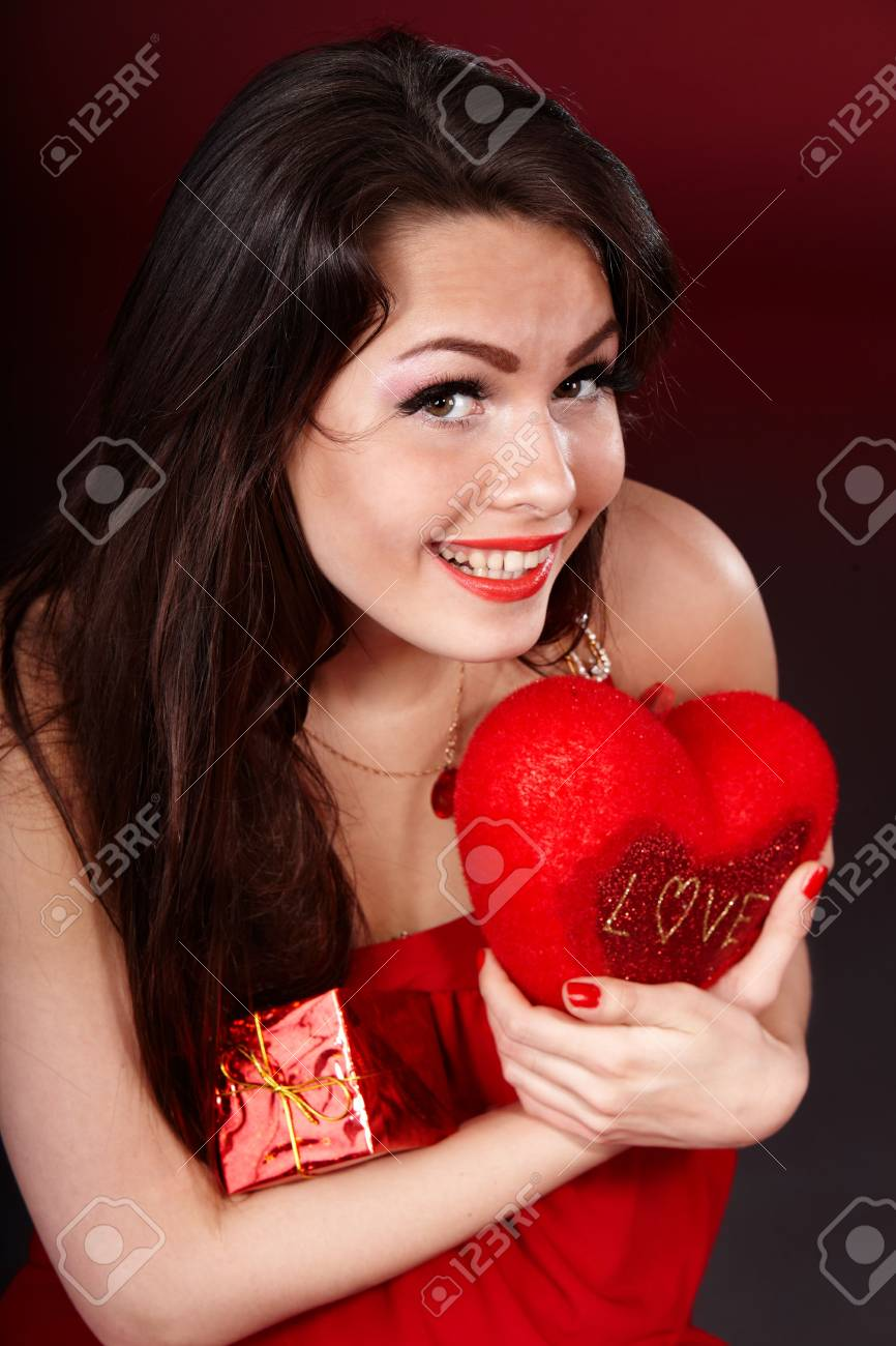 Girl with  heart  and gift box on red  background.   Valentines day. Stock Photo - 6283883