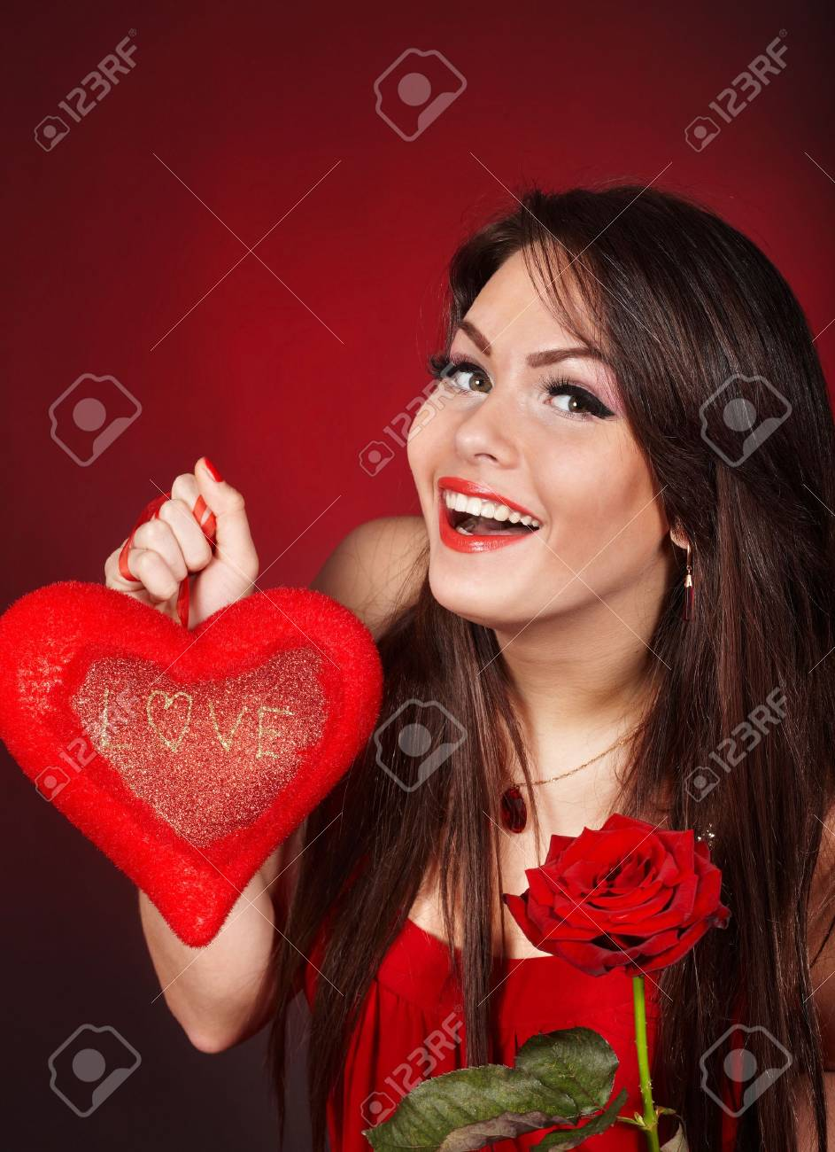 Girl with  heart and flower rose on red  background.  Valentines day. Stock Photo - 6281548
