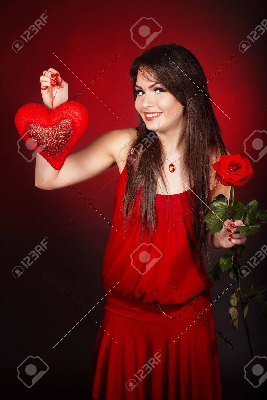 Girl with  heart and flower rose on red  background.  Valentines day. Stock Photo - 6283880