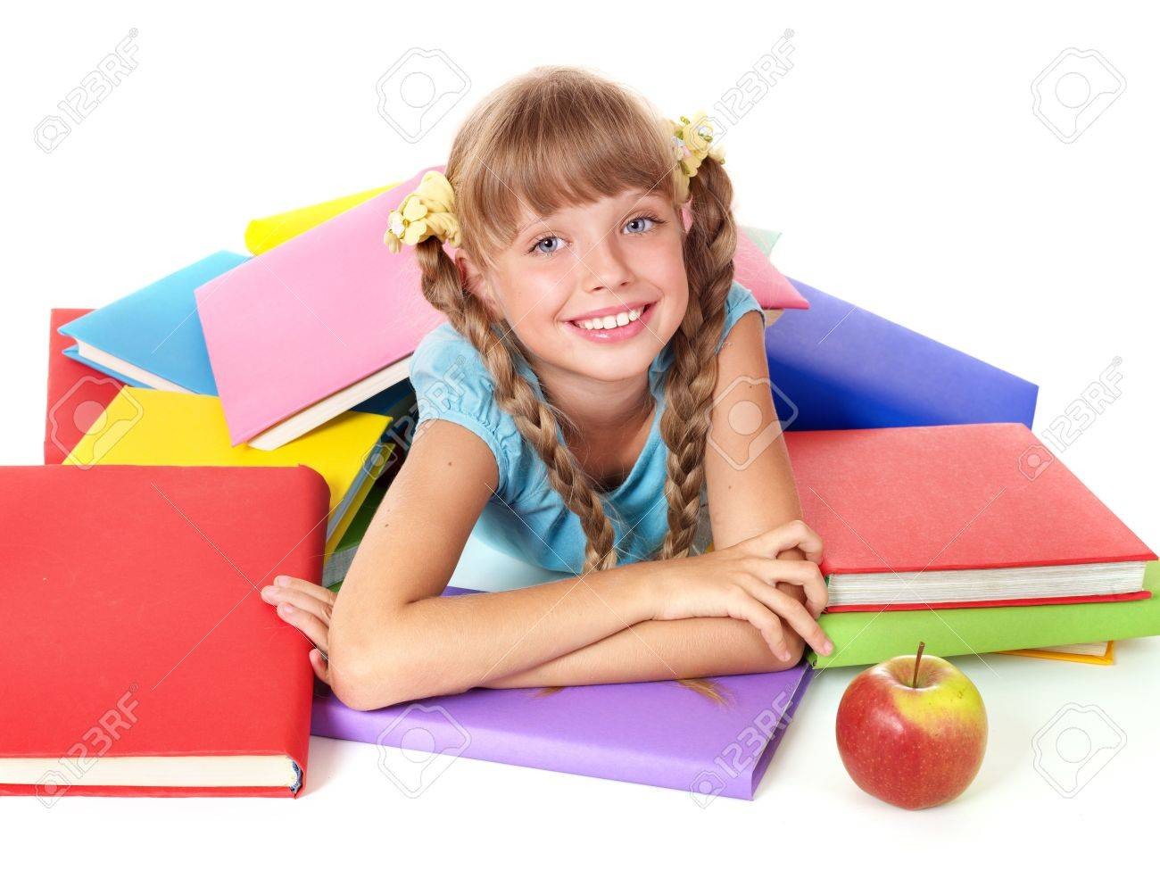 Little girl with pile of books and apple. Isolated. Stock Photo - 7450551