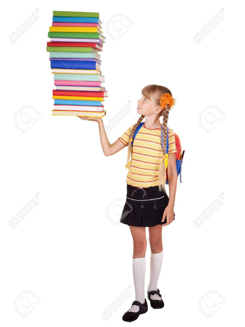 Schoolgirl with backpack holding pile of books. Isolated. Stock Photo - 7450517