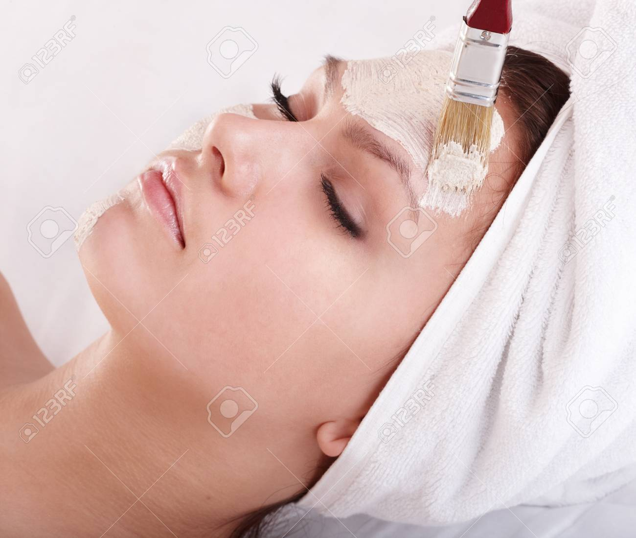 Young womanl with clay facial mask. Stock Photo - 7777815