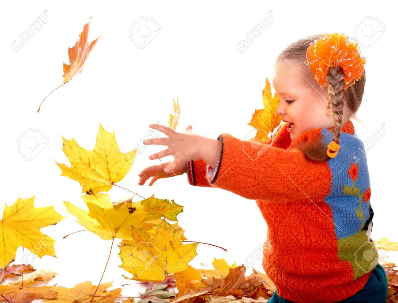 Little girl in autumn orange leaves. Isolated. Stock Photo - 7777916