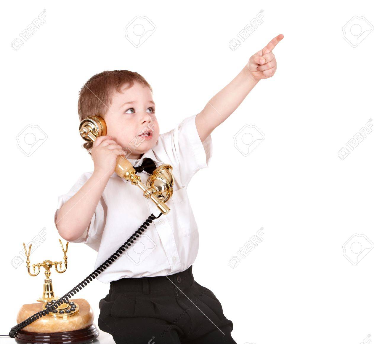 Boy in business suit with telephone point. Isolated. Stock Photo - 7778791