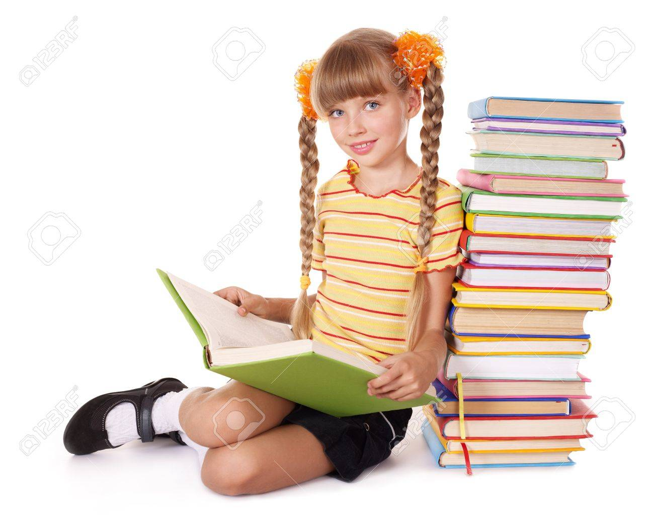 Little girl  reading  pile of books. Isolated. Stock Photo - 7779699