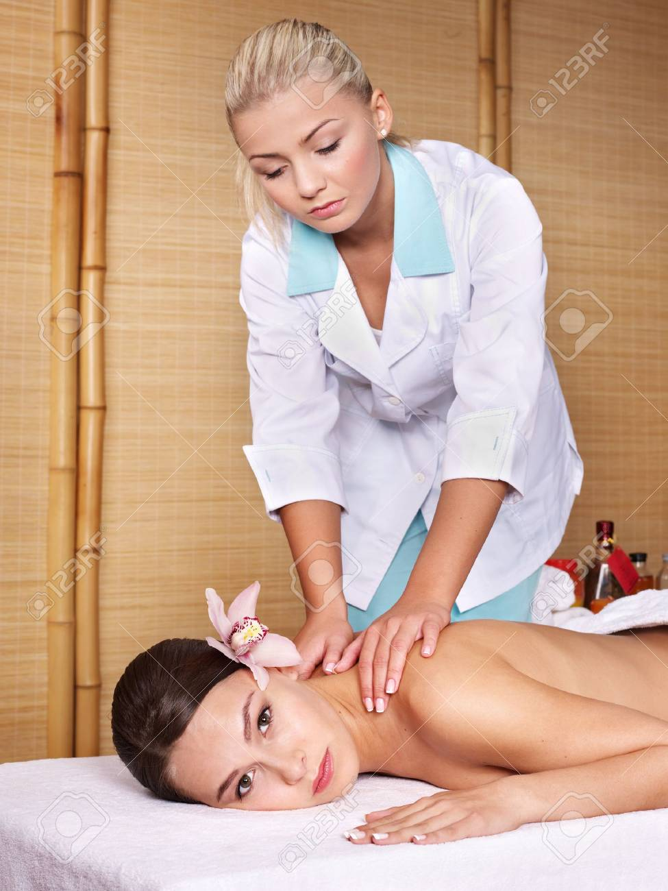Young beautiful woman on massage table in beauty spa.  Series. Stock Photo - 7779750